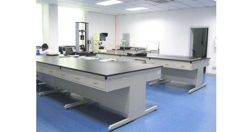 C-frame lab table without cabinets.
